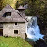 quiet cottage by a waterfall