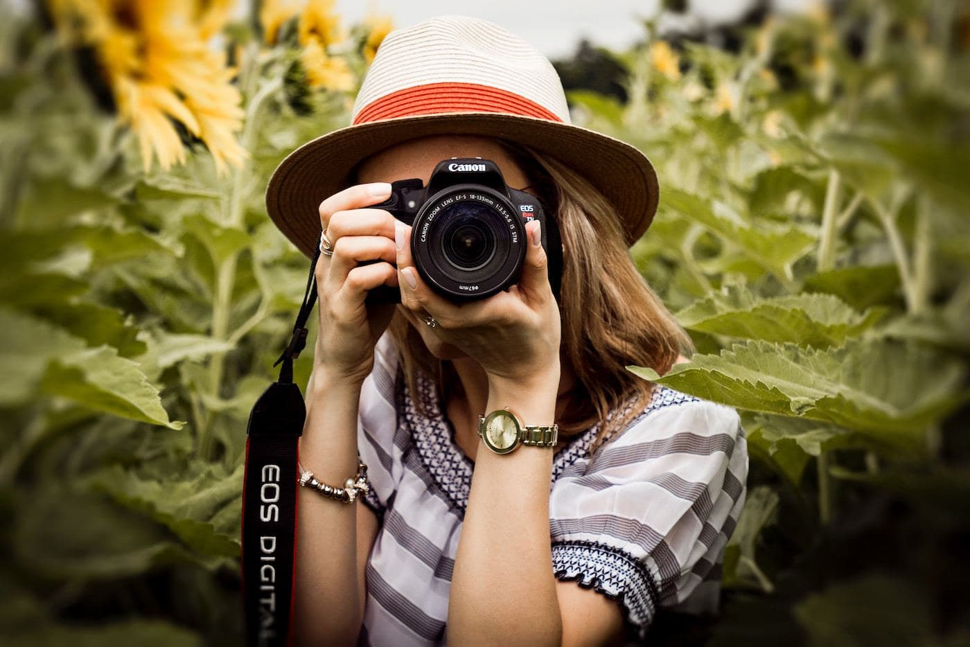 girl photographer with camera outdoors freelance photography